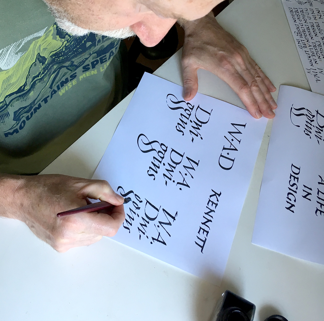 Photograph showing Richard Lipton working on the spine lettering for Bruce Kennett's forthcoming book on W. A. Dwiggins.
